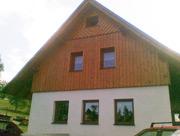 Dřevěný obklad štítu